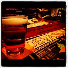 Photo taken at Devassa by Luiza E. on 4/4/2012