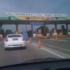Photo taken at Gerbang Tol Moh. Toha by Arief H. on 3/12/2012