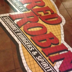 Photo taken at Red Robin Gourmet Burgers by Devin D. on 2/20/2012