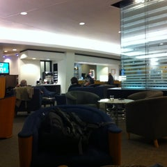 Photo taken at Delta Sky Club by Brad L. on 2/25/2012
