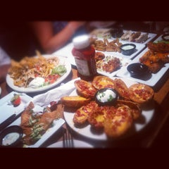 Photo taken at TGI Fridays by Danni S. on 9/1/2012