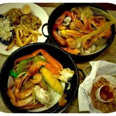Photo taken at Joe's Crab Shack by Maria C. on 7/24/2012