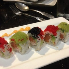 Photo taken at Sushi Axiom by Shay J. on 8/18/2012