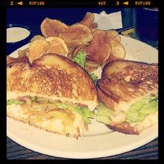 Photo taken at Tyler's Restaurant & Taproom by Ashley C. on 7/21/2012