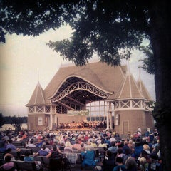 Photo taken at Lake Harriet Band Shell by Justin B. on 7/22/2012