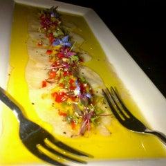 Photo taken at Andre's Cucina & Polenta Bar by Mark O. on 3/5/2012