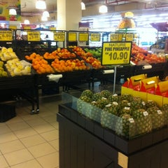 Photo taken at Village Grocer by Nina J. on 5/15/2012