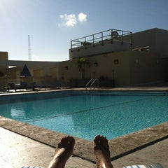 Photo taken at Hilton Hotel Rooftop Pool by Odie S. on 3/25/2012