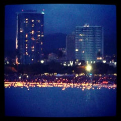 Photo taken at Memorial Day Lantern Floating Ceremony @ Ala Moana Beach Park by Carol N. on 5/29/2012