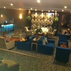 Photo taken at Kensington Close Hotel by Willard B. on 6/2/2012