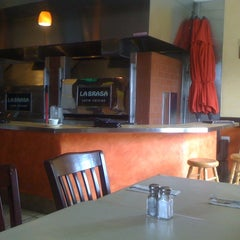 Photo taken at La Brasa Latin Cuisine by Juan S. on 7/20/2012