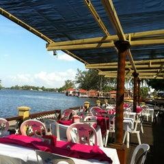 Photo taken at Restaurante Puerto Ceiba by Roberto A. on 3/14/2012