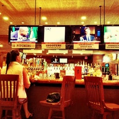 Photo taken at Smokey Bones Bar & Fire Grill by Jan F. on 2/11/2012