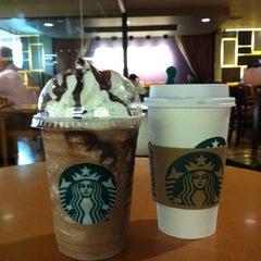Photo taken at Starbucks (สตาร์บัคส์) by Bo W. on 2/17/2012