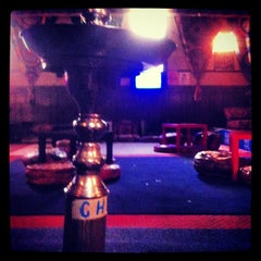 Photo taken at Sphinx Hookah Bar & Cafe by Craig H. on 4/10/2012