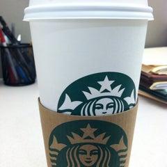 Photo taken at Starbucks by Rico E. on 4/20/2012
