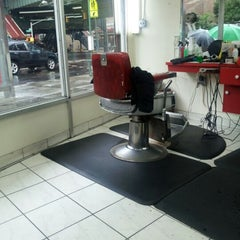 Photo taken at Dominguez Barbershop by Jose M. on 8/10/2012