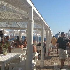 Photo taken at La Spiaggia Beach by Vasilisa T. on 8/15/2012