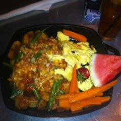 Photo taken at Hash House A Go Go by Bill B. on 7/27/2012