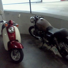 Photo taken at lonely bella the scooter at new job by Erin T. on 5/16/2012