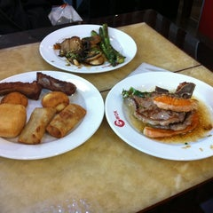 Photo taken at Wok Hui Feng by María C. on 3/13/2012