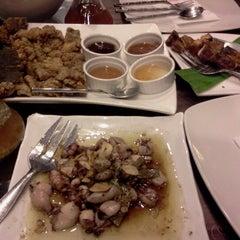 Photo taken at Mesa Filipino Moderne by Mai O. on 8/25/2012