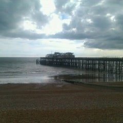 Photo taken at Hastings Pier by Gustav G. on 3/18/2012