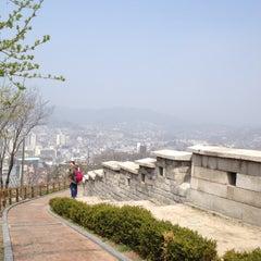Photo taken at 낙산공원 (Naksan Park) by Kanyasiri C. on 4/14/2012