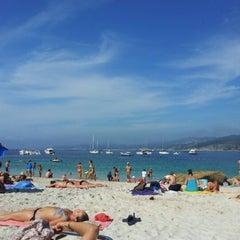 Photo taken at Praia de Castiñeiras by Pablo R. on 8/8/2012