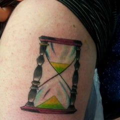 Photo taken at 24 Hour Tattoo by Paul H. on 6/8/2012