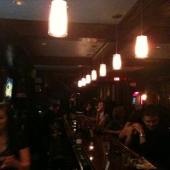 Photo taken at The Rowhouse Grille by Paul B. on 3/4/2012