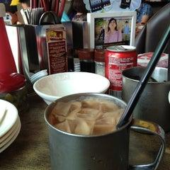 Photo taken at Xin Wang Hong Kong Café 新旺香港茶餐厅 by K C. on 9/2/2012