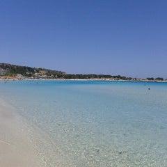 Photo taken at Spiaggia San Vito Lo Capo by Simone L. on 6/12/2012