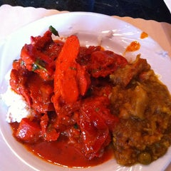 Photo taken at New Delhi Indian Restaurant by Heather S. on 4/29/2012