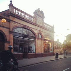 Photo taken at Barons Court London Underground Station by Rubo S. on 9/12/2012