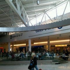 Photo taken at Gate 20 by rebecca p. on 3/27/2012