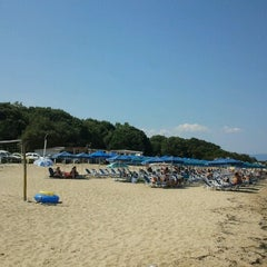 Photo taken at Totos Beach Bar by Dimitris S. on 8/18/2012