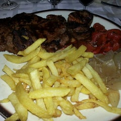 Photo taken at Restaurante El Cortijo by Ruben G. on 8/4/2012