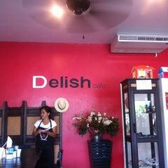Photo taken at Delish Cafe by Ekaterina P. on 3/8/2012