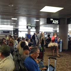 Photo taken at Gate A30 by Allen S. on 9/9/2012
