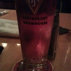 Photo taken at BJ's Restaurant and Brewhouse by Mabel E. on 2/4/2012