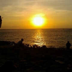 Photo taken at Pantai Senggigi by desi a. on 9/12/2012