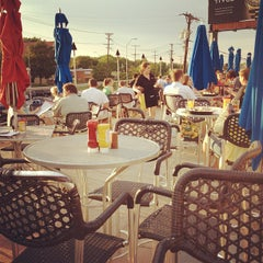 Photo taken at The Well Bar Grill & Rooftop by Joey L. on 5/28/2012