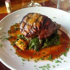 Photo taken at Toulouse Petit Kitchen & Lounge by Nicolas T. on 6/28/2012