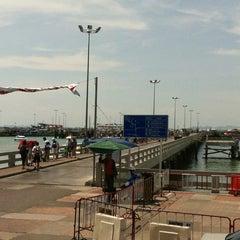 Photo taken at Bali Hai Pier by Angie P. on 5/12/2012