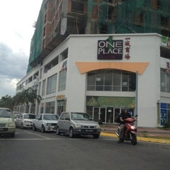 Photo taken at One Place Mall by Rzal M. on 9/1/2012