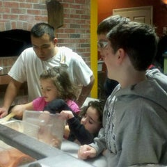 Photo taken at Nino's Coal Fired Pizza by Lisa C. on 2/13/2012
