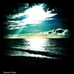 Photo taken at Ehukai Beach by Daniela A. on 7/21/2012
