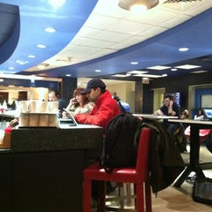Photo taken at Delta Sky Club by Jrod K. on 3/8/2012