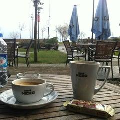 Photo taken at Caffé Nero by Melis U. on 3/9/2012